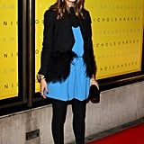 Olivia stepped out for Victoria Beckham's latest collection, grounding a Spring-ready blue dress with wintry add-ons.
