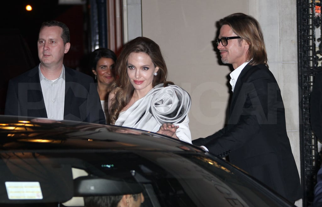 Brad Pitt and Angelina Jolie followed up her Paris premiere of In the Land of Blood and Honey with dinner at the city's Tour D'Argent restaurant. She was still decked out in a one-shouldered gown from designers Ralph & Russo, paired with Lorraine Schwartz jewels and Jimmy Choo shoes. They were joined at the famous spot, which was founded in the 1500s, with some members of her cast, like actresses Vanesa Glodjo and Zana Marjanovic. Angelina has been spending a great deal of time with her leading ladies, as they're in the midst of a European press tour. They kicked things off last weekend at the Berlin International Film Festival, and also stopped in Sarajevo for a special premiere in the city where much of the action in her film takes place. The traveling will continue today for the Jolie-Pitts, as Angelina's attending the Croatian premiere tonight.