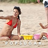 Alessandra Ambrosio enjoyed a family vacation in Hawaii playing with her daughter, Anja, in the sand in August 2010.