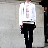 A bold piece, in this case the attendee's cutout jacket, can transform basics like a turtleneck and trousers.