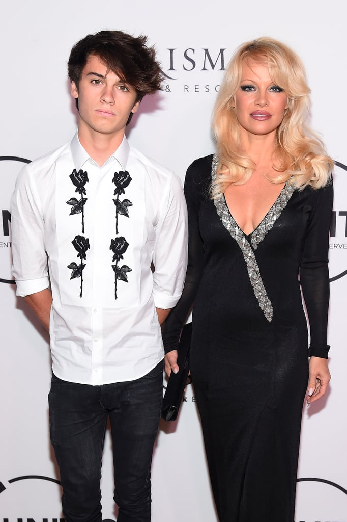 """Pamela Anderson dropped jaws in an elegant black Ekaterina Kukhareva gown at the Unitas Gala Against Human Trafficking in NYC on Tuesday night. The Baywatch beauty was joined by her younger son, Dylan Jagger Lee; the 18-year-old aspiring model posed for photos with his mom on the red carpet before heading inside, where they sat together for the event. Dylan shared a photo of the duo on Instagram that evening, writing, """"Great event for a great cause."""" Dylan, along with his 20-year-old brother, Brandon, is the son of Pam and her former husband Tommy Lee. Pam recently made headlines when she penned an opinion piece about the dangers of pornography for the Wall Street Journal. The former Playboy centerfold argued that porn """"killed"""" the men's magazine and that the """"terrible addiction . . . is ruining relationships."""" Pam also alluded to the infamous 1995 sex tape featuring herself and Tommy — the tape was taken from their home and distributed illegally — saying, """"I know sometimes people think it's hypocritical of me because there was a tape stolen from my house, [but] I'm talking about violent porn."""""""