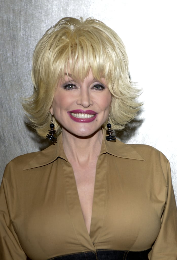 By 2002, Dolly Parton's Signature Look Had Become Flared-Out Hair With ...