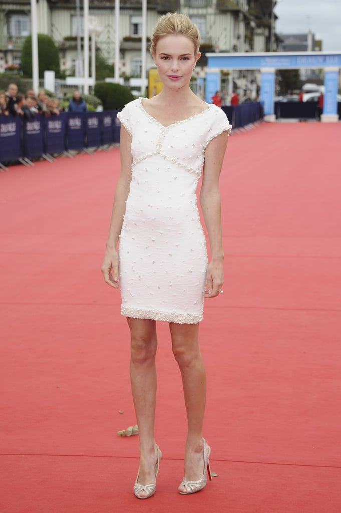 Kate wore a white Chanel mini-dress at the Another Happy Day photocall in France in September 2011.