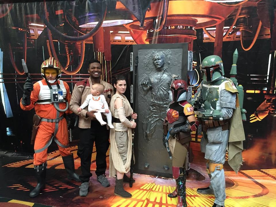 The couple stands with a variety of Star Wars characters, including Han Solo.