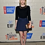 Emma married navy and black, topping her pleated A-line skirt with an embellished Kate Spade New York sweater for Hollywood's 2014 Stand Up to Cancer event. Rose gold pumps and a coordinating minaudière played up her jeweled neckline perfectly.