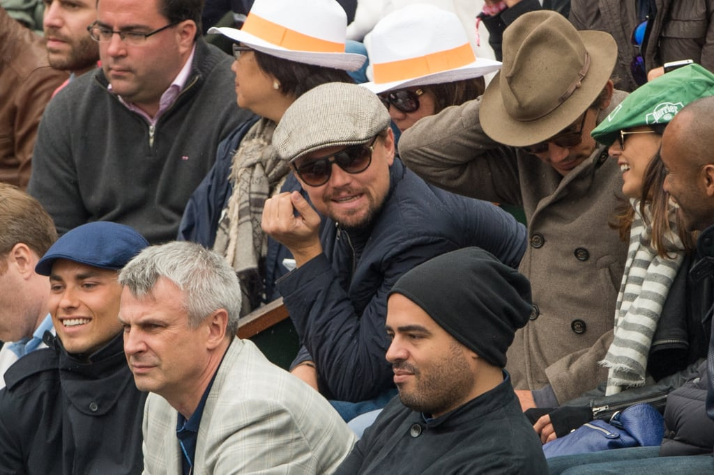 """Leonardo DiCaprio was back in the stands at Roland Garros Stadium as a spectator at the French Open finals in Paris yesterday. He had his pal Lukas Haas next to him to watch Rafael Nadal beat David Ferrer on the court. Leo and Lukas have been popping up in the crowd together throughout the tournament and took in the semifinals earlier in the weekend. While Leo was overseas, he made headlines in Hollywood for reportedly taking on the role of Rasputin in an upcoming biopic, which was recently acquired by Warner Bros. The news of his latest big-screen undertaking may come as a surprise since Leo announced last month that he was planning on taking a break from acting. He said, """"I am a bit drained. I'm now going to take a long, long break. I've done three films in two years and I'm just worn out."""" After completing his press duties for The Great Gatsby and wrapping up shooting on his upcoming film The Wolf of Wall Street, Leo has taken advantage of his downtime so far. He's been relaxing on his current European Summer tour, which included sightseeing around Paris with his new rumored girlfriend, Toni Garrn, last week."""