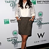 Katie Lee Joel always dresses to impress. Her bib-front blouse, the studded skirt, and especially those peep-toe booties are all fresh.
