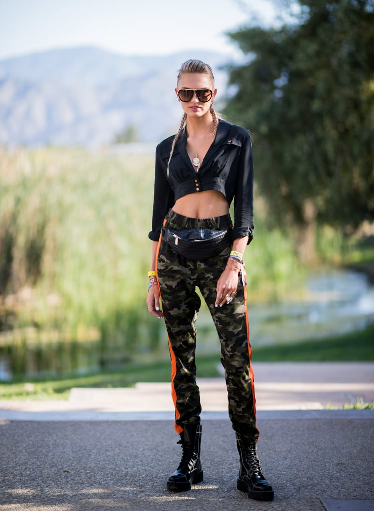 Romee Strijd wore a crop top and camo pants. She accessorized with a necklace from Parpala Jewelry.