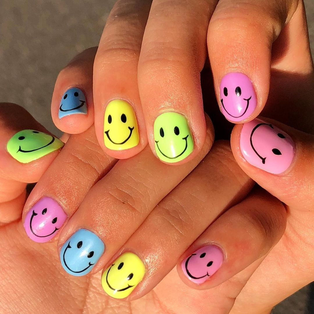 Smiley Face Nail Art Trend Inspiration Popsugar Beauty With a neon yellow base and a toothpick or dotting tool dipped in black polish, you can easily bring this look to life. smiley face nail art trend inspiration