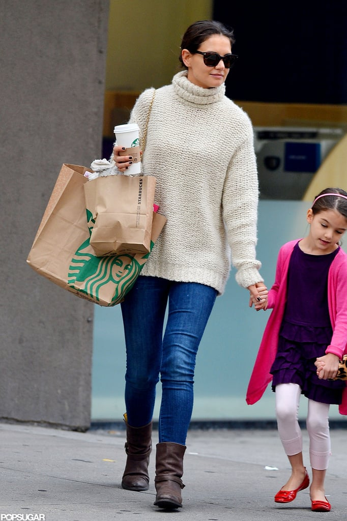 Suri Cruise held her mom Katie Holmes's hand yesterday leaving an NYC Starbucks. Katie and Suri picked up treats along with another young pal. Yesterday was the end of a month full of highlights for Katie and Suri —Suri started school and Katie made her NYFW debut with a first-ever Lincoln Center presentation of her Holmes & Yang line. The excitement will continue into the Fall, too. Katie will hit the stage on Broadway in Dead Accounts for 16 weeks starting Nov. 3. It's not her first time on the NYC stage, though, since she also appeared in 2008's All My Sons.