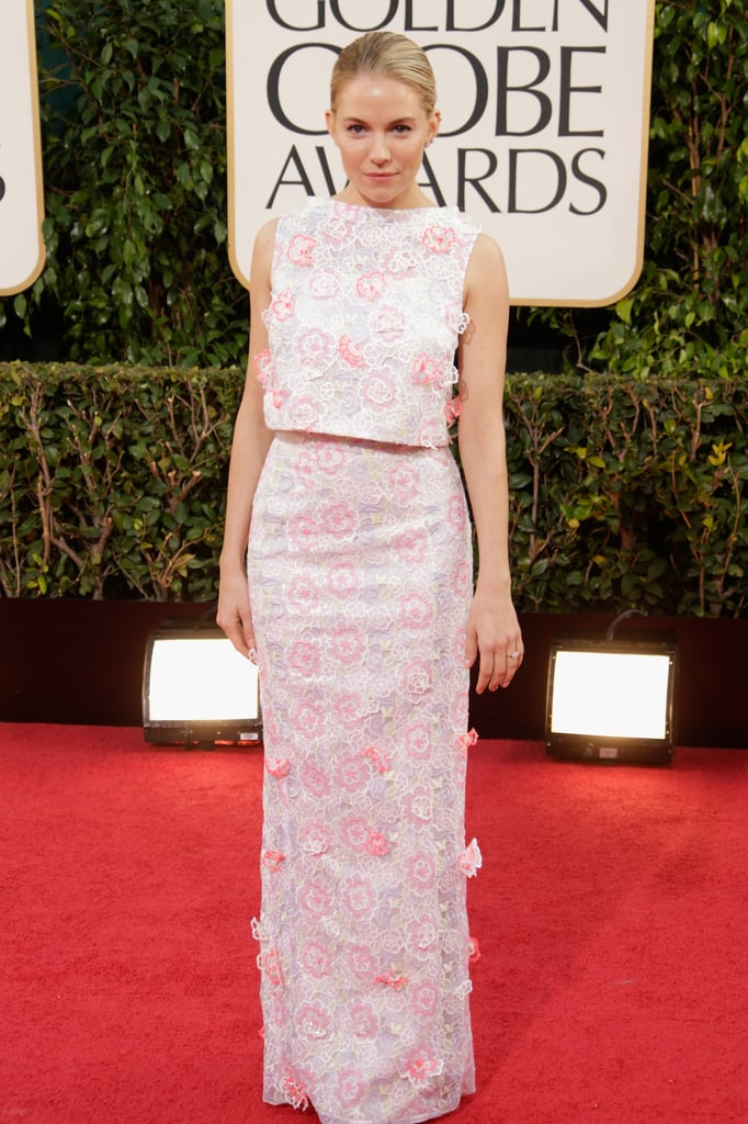 For the 2013 Golden Globe Awards, Sienna dolled up in a whimsical floral-embroidered Erdem crop top and long skirt combo.