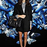 At Mulberry, Alexa Chung showed off her affinity for menswear-inspired styles in a shorts suit, metallic booties, and a midnight-blue Mulberry bag from the Fall 2013 collection.