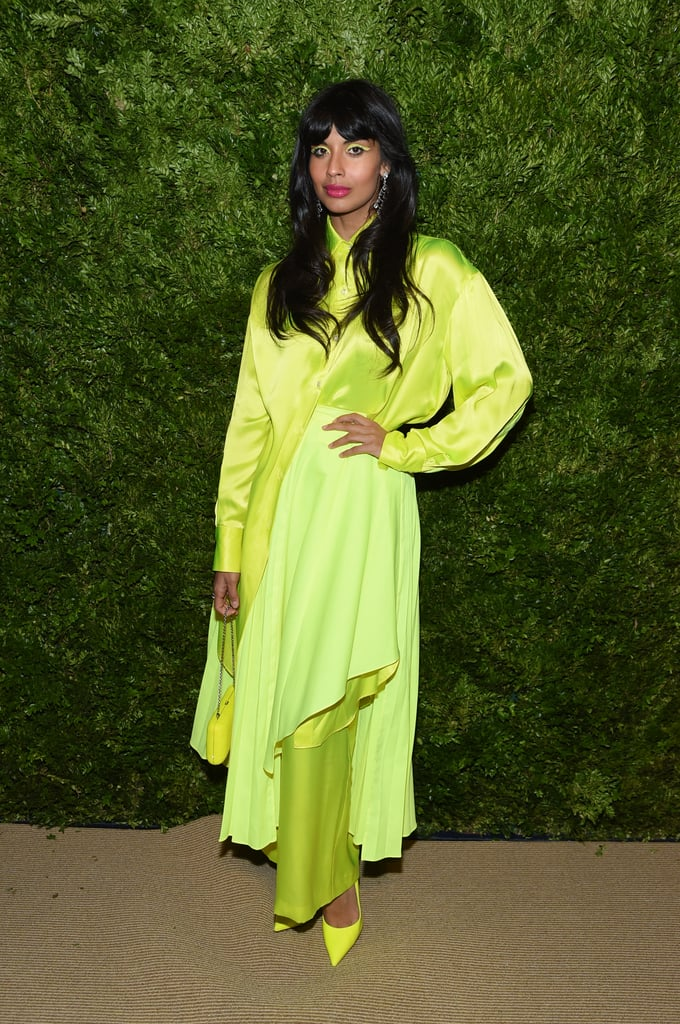 "Shine bright like a diamond Jameela! On Monday night, the stars came out for the 2019 CFDA Fashion Fund Awards in New York City, and in a sea full of stunning celebrities and designers, Jameela Jamil radiated among the crowd. The Good Place actress dressed head to toe in a neon yellow ensemble designed by Christopher John Rogers, who had a huge night himself. The 25-year-old designer was honored with the prestigious CFDA/Vogue Fashion Fund Award, and Jameela looked fabulous representing his brilliant designs.  Jameela proved there's no such thing as too much neon, as she paired bright pumps with a matching purse and her layered asymmetrical outfit, taking the monochrome trend to a whole new level. She always prioritizes comfort at award shows and red carpet events, and her latest outfit was exactly that (plus super stylish). Jameela even did her own makeup! At the event on Monday, she and longtime boyfriend James Blake posed for photos, and she joked on Twitter, writing, ""No cars hit me last night!"" Check out photos of Jameela's glowing Christopher John Rogers outfit at the 2019 CFDA/Vogue Fashion Fund Awards, and be inspired to continue the neon trend all through the Fall."
