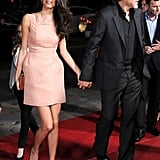 Wearing a pink Roland Mouret cocktail dress to the Our Brand Is Crisis premiere in 2015. She accessorized with a gold clutch, pumps, and drop earrings.
