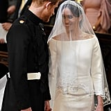 She accessorised her gown with a diamond-encrusted bandeau tiara, sparkling jewels, and a cathedral-length veil, which represented the distinctive flora of each Commonwealth country.