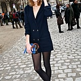Taking in Louis Vuitton's A/W '09 collection in an oversize cardigan, tights, and fabulous footwear.