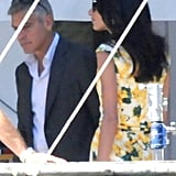 Amal Alamuddin stopped by an Italian set to see her fiancé, George Clooney, on Wednesday.