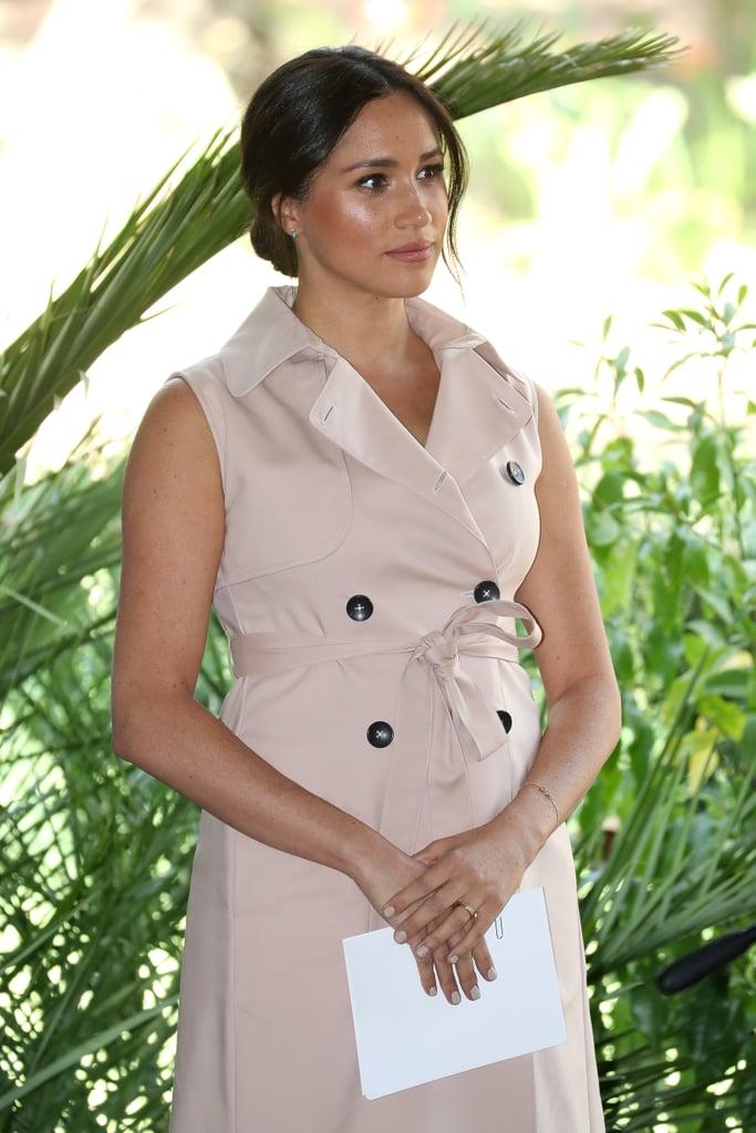 Meghan Markle Wearing an Evil Eye Bracelet and Beige Trench Dress