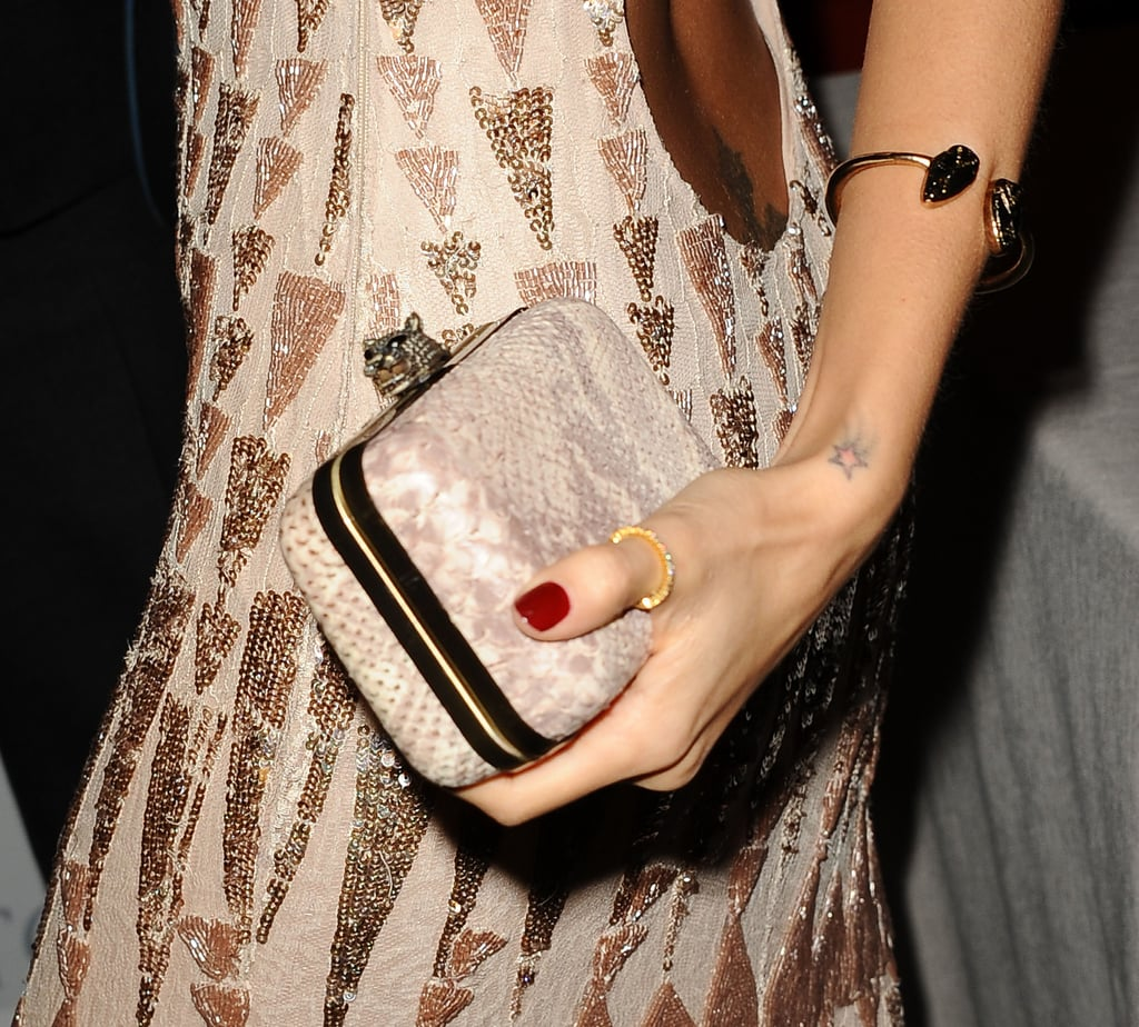 A tiny shooting star on Nicole's wrist acts like an accessory.