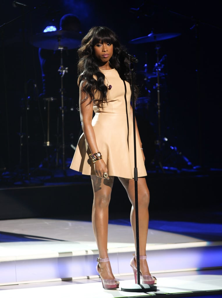 """Jennifer Hudson made a quick stop in Washington, DC yesterday morning before taking the stage at NYC's Lincoln Center during Nickelodeon's upfront presentation to belt out her new single """"Where You At."""" She's back in the US after a trip to Paris Fashion Week, where she showed off her svelte figure at a cocktail party honoring Michael Kors. She's been busy working with celebrity trainer Harley Pasternak as she gears up for the release of her newest album, I Remember Me, on March 22, and showed off the results of her efforts again last night in a sexy leather minidress."""