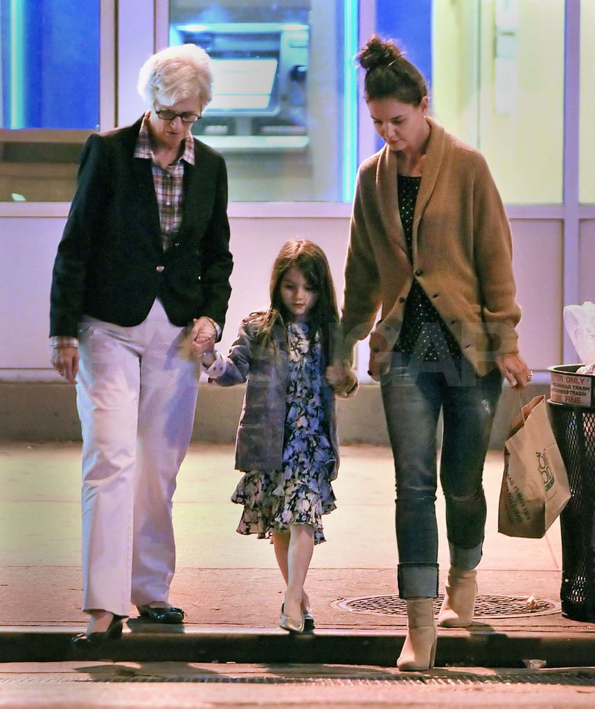 It was safety first for Suri Cruise, who held hands with mom Katie Holmes and grandma Kathleen Holmes leaving a Whole Foods in NYC yesterday. Katie and Suri are on the East Coast after a stint in LA, where they were spotted dining out in Brentwood. Katie also stepped out for a special Jimmy Choo and Hollywood Reporter event that celebrated Katie's stylist, Jeanne Yang, among others. Charlize Theron was also at the luncheon, where she apparently chatted with Katie about her newly adopted son, Jackson. Jackson hasn't been seen with Charlize as she travels to promote Snow White and the Huntsman, but she did talk about her 4-month-old during an appearance on the Today show.
