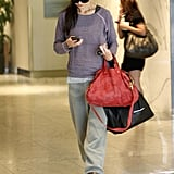 Katie Holmes with a red bag.