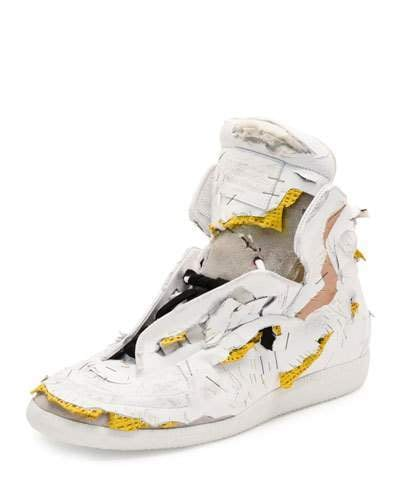 The Maison Margiela Future Destroyed High-Top Sneaker, White/Yellow ($1,425) emulates a piece of trash — in the best possible way.