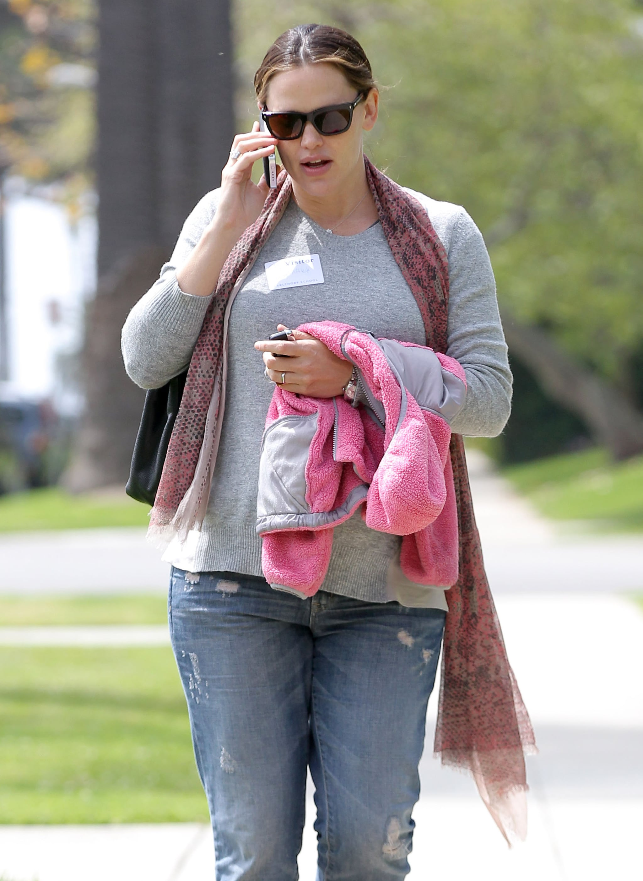 Jennifer Garner layered a scarf over her casual look.