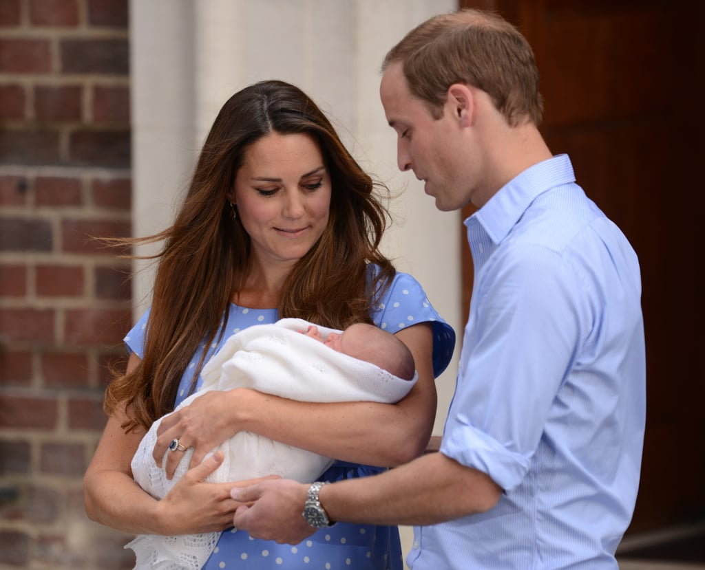 Kate, peering lovingly at her firstborn, the day she became a mama.