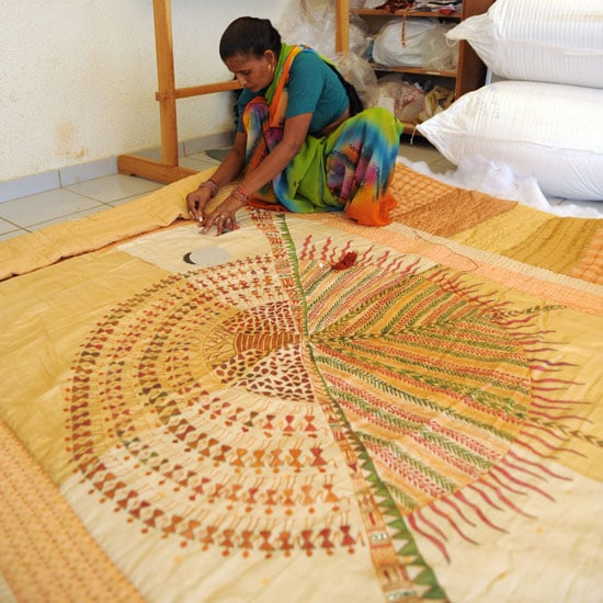 An Indian Woman Stitches An Intricate Quilt Indian