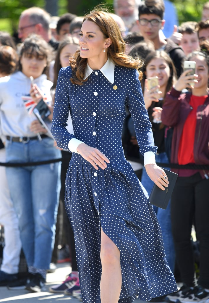 "The Duchess of Cambridge just wore the perfect Summer transition dress on her latest royal outing, and it's one she's worn before.  During a visit to Bletchley Park for a special D-Day exhibition, the Duchess of Cambridge slipped into her navy, ankle-grazing Alessandra Rich dress. Recognise this springtime outfit? That's because she first wore it for the special royal family portraits celebrating Prince Charles's 70th birthday back in November of last year. It's such a good dress, she's brought it back again. It's proving quite a popular dress among the wider royal circle, too. We spotted it on Abigail Spencer at Meghan Markle and Prince Harry's wedding in May 2018. It seems this particular dress is reserved for special occasions. During her visit to Bletchley Park, Kate was surprised with two bricks on the ""Codebreakers' Wall"" dedicated to her grandmother and great-aunt, who were veterans of WWII.  Polka dot is a favourite print for Kate. She wore this forest-green polka-dotted LK Bennett midi dress with pearl button details in 2018. The duchess turned to another fashion go-to with her jewellery, choosing her trusty Annoushka pearl earrings.   Ahead, get a closer look at the dress, and yes, we've already added a polka-dot dress to our wish lists."