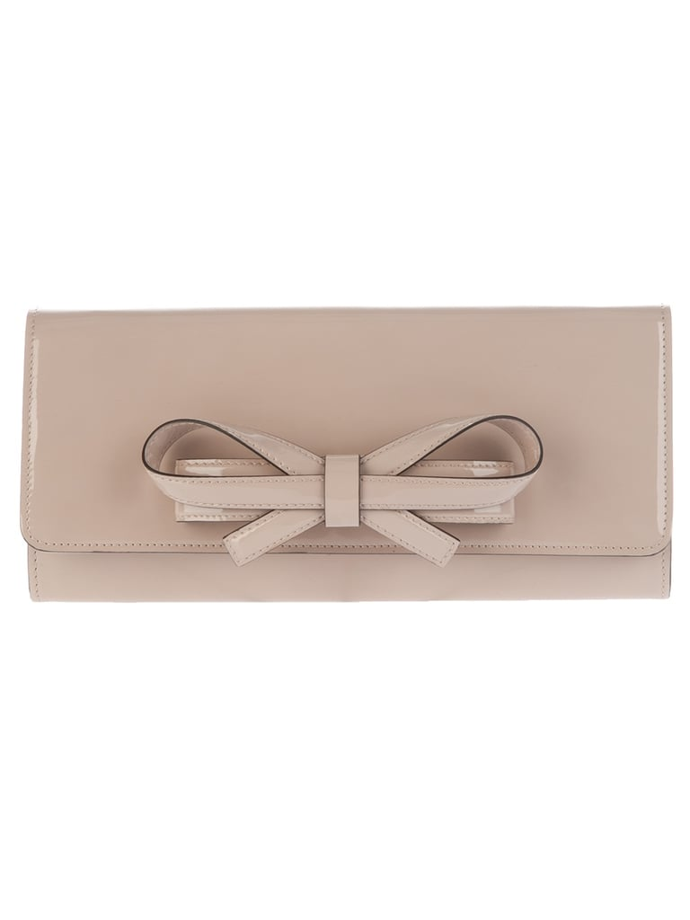 Ladylike without erring on the side of being too girlie — we love this nude-toned clutch for evenings out on the town. Valentino Bow Detail Clutch ($991)
