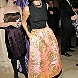 Anna Wintour looked ladylike as ever in a printed skirt and black top.