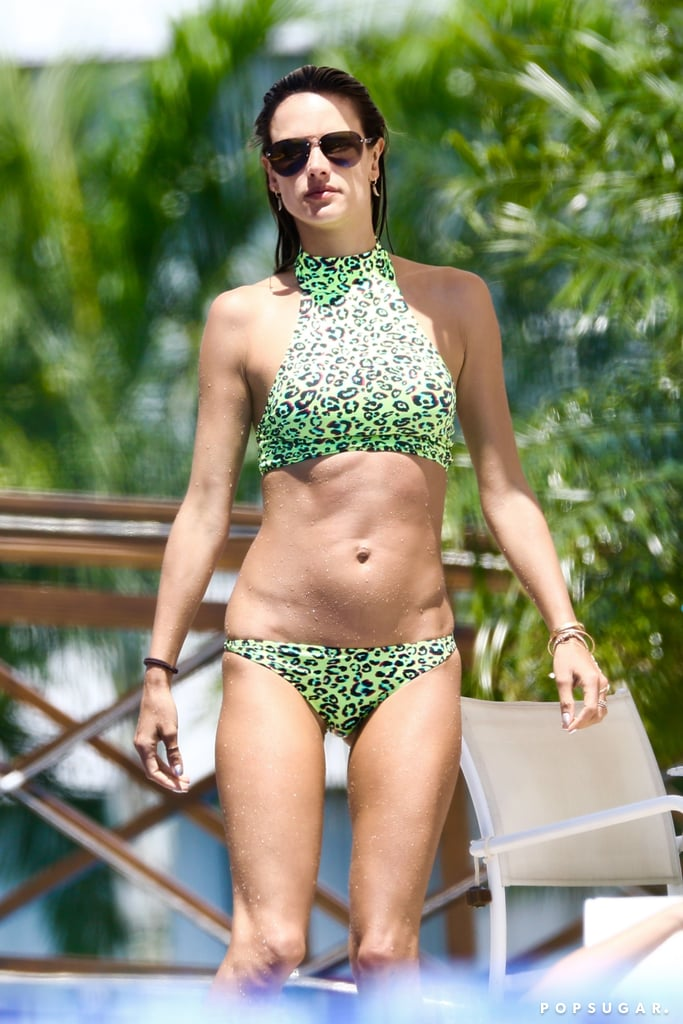 By now, we're thoroughly convinced that all Alessandra Ambrosio packed for her Brazil vacation were swimsuits. The model has been showing off one style after another (we loved this two-tone one piece) and no two designs were ever the same. As if to make her point, Alessandra recently wore a bright green leopard print bikini to the pool. The top was a halter-neck style while her bikini bottoms sat low on her hips. The unconventional neon color definitely caught our attention first, and it's one of the boldest swimsuits she's worn to date. Scroll on to see her bikini from all angles, then shop similar selections that are just as colorful.       Related:                                                                                                           Alessandra Ambrosio's Sexy Bikini Photos Are Sure to Make You Hyperventilate