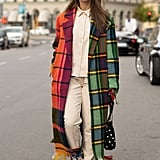 Keep the rest of your look simple, but make a statement with a plaid coat.