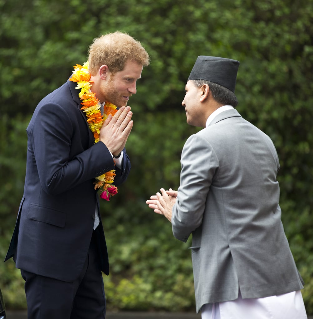 """Following his trip to Epping Forest, Prince Harry attended a ceremony to celebrate the bicentenary of relations between the UK and Nepal at the Embassy of Nepal in London on Monday. The young royal was presented with a photograph from one of his previous visits to the country and caught up with old friends Hari Budha Magar and Vinod Budhathoki, who served alongside him in Afghanistan. The Duke and Duchess of Cambridge were not in attendance, but they recently returned from their two-day trip to Paris over the weekend.  In March 2016, Harry became the first British royal to visit Nepal since the monarchy was eliminated back in 2008. During his five-day tour of the country, he met with the prime minister and president, visited with the survivors of the tragic earthquake in Bhaktapur, and was dubbed """"village head man"""" during a visit to the town of Leorani."""