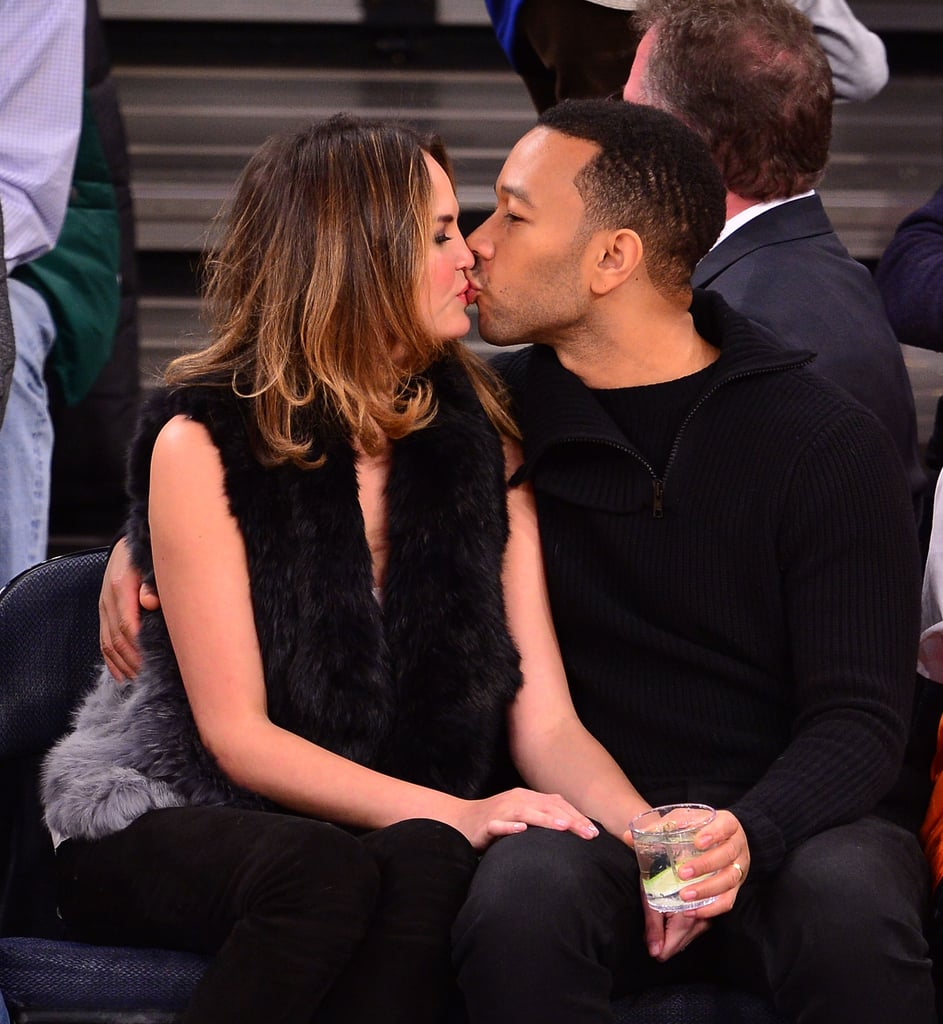 John laid a smooch on his new bride during a NY Knicks game in January 2014.