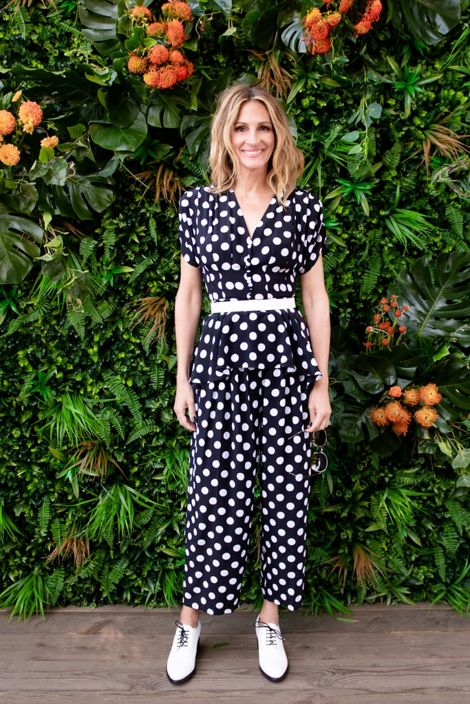 Julia Roberts embraced her inner pretty woman on Monday in a pair of polka-dot pants and a matching peplum top that Vivian Ward would so approve of. Julia paired the Michael Kors look — which she wore to the 10th anniversary of the Veuve Clicquot Polo Classic in Los Angeles — with orange-tinted sunglasses, a white belt, and a pair of black-and-white heeled oxford shoes — cute! The look bore a huge resemblance to her brown-and-white polka-dot dress from Pretty Woman, which she coincidentally wore while attending a polo match in the film. Whether or not this throwback look was intentional, we're absolutely feeling the Vivian vibes and loving them. Keep scrolling to compare Julia's two polka-dot looks almost 30 years apart.      Related:                                                                                                           Kate Middleton's Polka-Dot Dress Is So Good, It's Become a Royal Wardrobe Staple