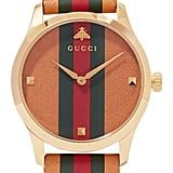 Gucci G-Timeless Striped Leather and Gold-Tone Watch ($1,490)
