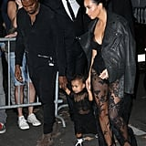 Kim Kardashian, Kanye West, and North West at the Givenchy Show in 2014