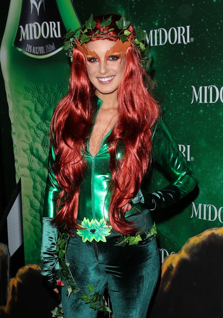 Shenae Grimes dressed as Poison Ivy from Batman at the Midori Green Halloween party in LA.