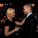 Justin was in deep conversation with Amy Poehler at the Producers Guild Awards in January 2011.