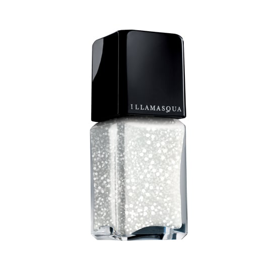 """Launching later this month, Illamasqua Blizzard ($17) is a new take on the typical glitter topcoat with white and silver flecks. Time to cue up """"Let It Snow."""""""