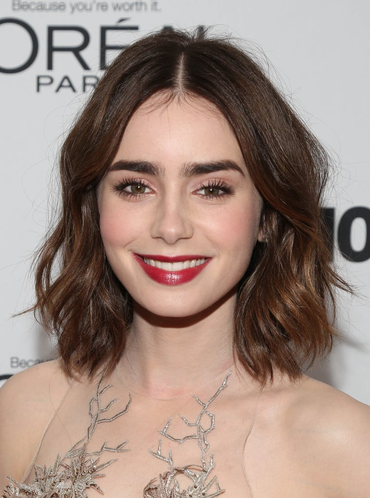 Lily Collins went with shimmering pink shadow on her eyes and a swipe of Lancome L'Absolu Rouge in Berry Noir ($30), a vibrant cherry lip color, to complete her look.
