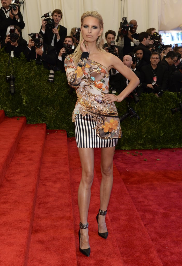 Karolina Kurkova stepped out in a mixed-print Mary Katrantzou minidress, finished with studded black ankle-strap pumps.
