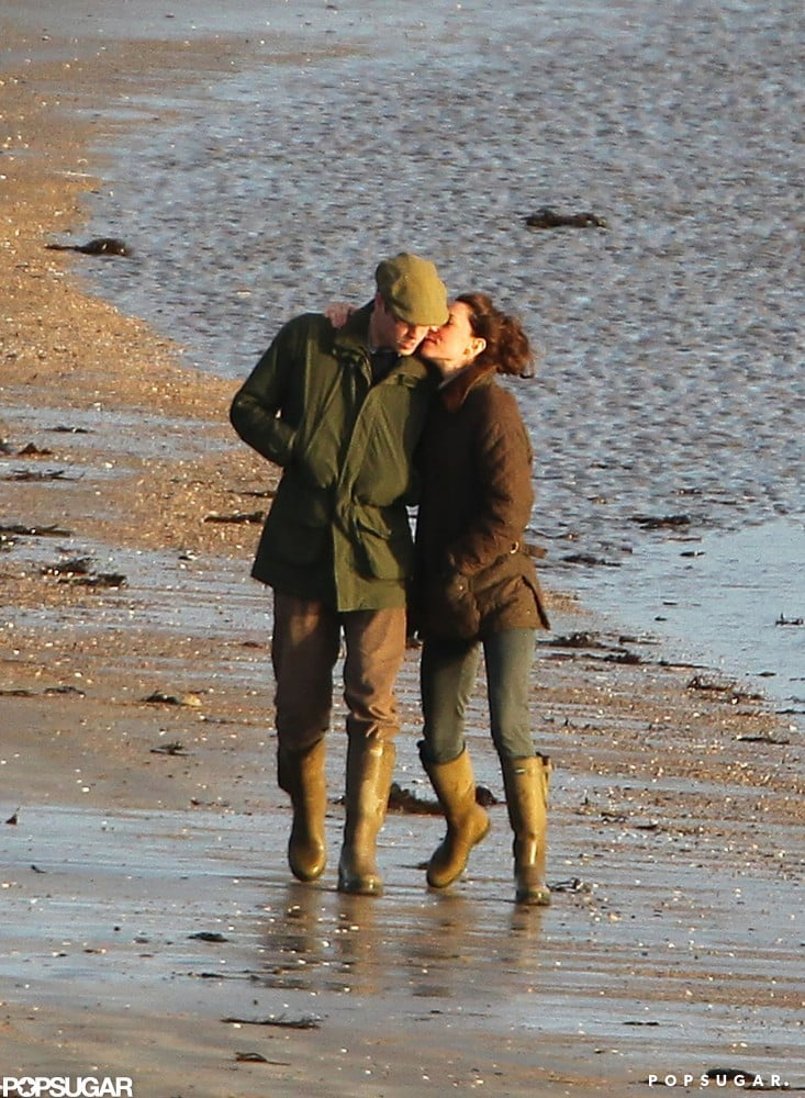 William and Kate cozied up during a January walk by the water in Wales in 2012.