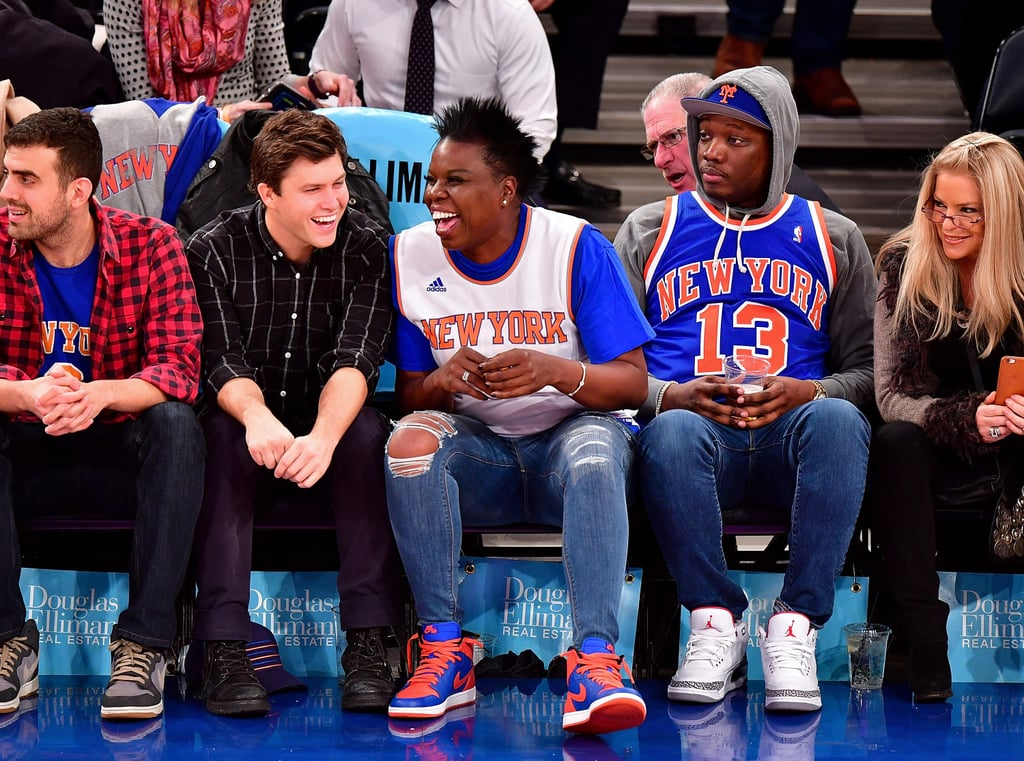 """On Saturday Night Live, Leslie Jones is known for sliding up to the Weekend Update desk and unabashedly hitting on Colin Jost — so to see the two sitting courtside together at a New York Knicks game on Tuesday night really warmed our hearts. Leslie and Colin were joined by their SNL costars Cecily Strong and Michael Che, who couldn't have looked more like a third wheel seated with them; he also had some hilarious facial reactions to Leslie's overzealous cheering for the team and snapped selfies of the crew. If the SNL cast didn't bring enough fun to the big game, also seated front row were Amy Schumer, Sam Morril, and Chris Rock, who chatted it up between quarters. The two worked together on Amy's 2015 standup special Amy Schumer: Live at the Apollo, and the Trainwreck star shared a cute photo of the group at the game, saying, """"Kids who told jokes till they got courtside.""""      Related:                                                                                                           They've Got Spirit! 50+ Pictures of Stars Freaking Out at Sports Games"""