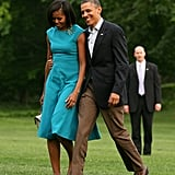 The Obamas walked together on the White House lawn.