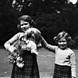 Aww! Elizabeth and Margaret posed with their dog Chu-Chu at the Royal Lodge in 1936.