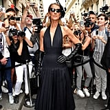 Shutting it down at Schiaparelli, Celine arrived in a halter-style dress, headpiece, and leather opera gloves.